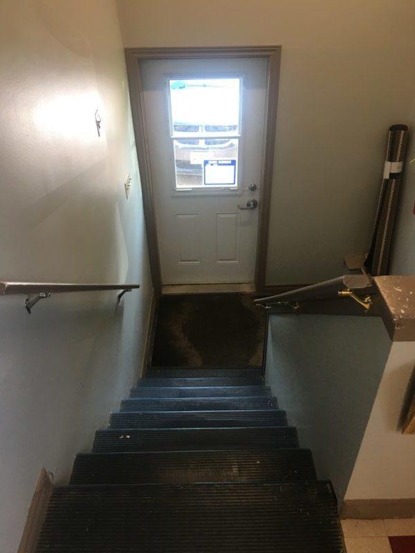 Dark, narrow, steep stairway